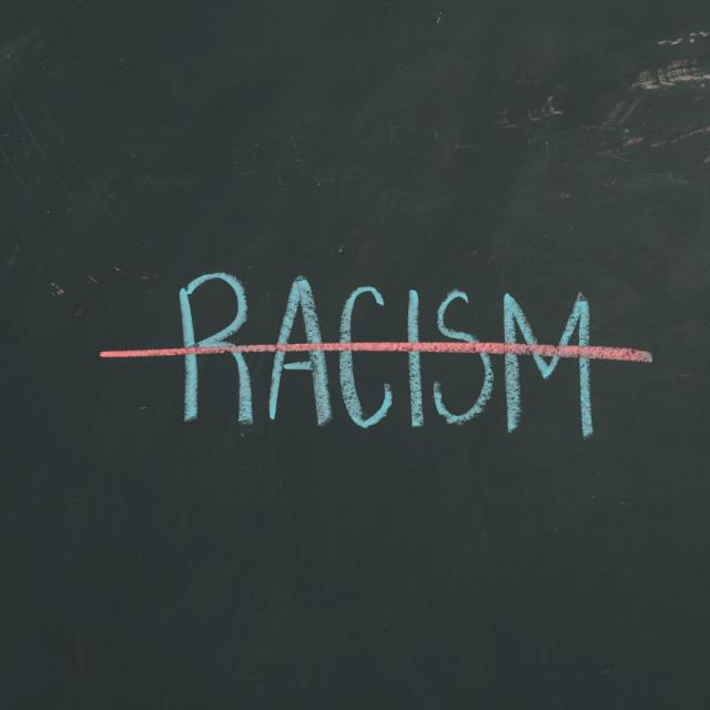 chalkboard-sign-letters-racism-illustration-id640899990